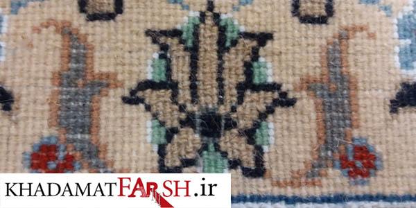 ترمیم کامل بیدخوردگی فرش دستباف از قسمت پشتی طوری که اصلا قابل تشخیص نیست .
